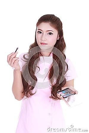 Free Woman Applying Eyeshadow Powder Stock Images - 41981594
