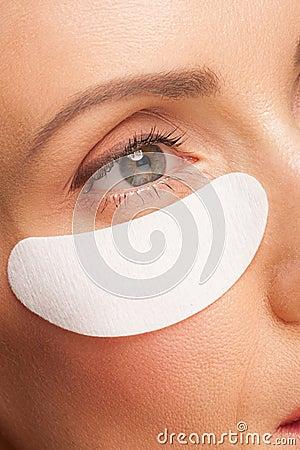 Free Woman Applying Gel Eye Mask Stock Image - 26817551