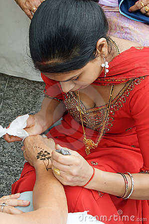 Woman applying Henna Editorial Stock Image