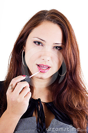Woman applying lip gloss on her lips