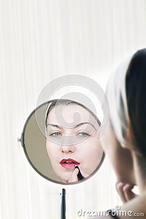 Woman applying lip stick