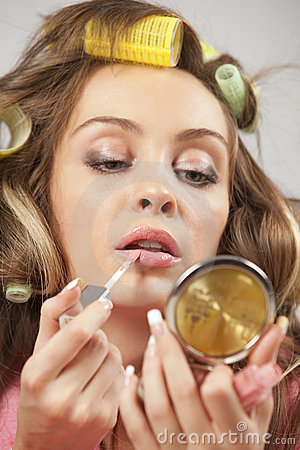 Free Woman Applying Liquid Glossy Lipstick Stock Images - 16967364