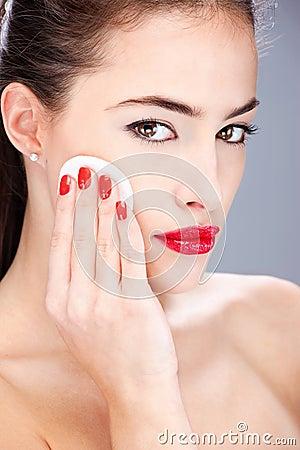 Woman applying make up with sponge