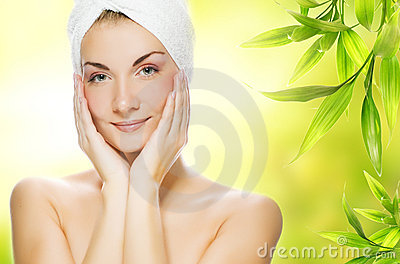 Woman applying organic cosmetics