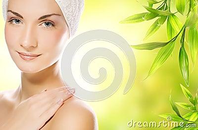 Woman applying organic cosmetics