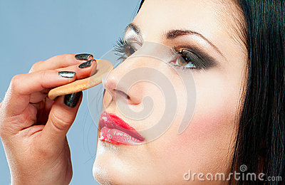 Woman applying powder