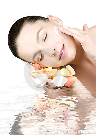 Free Woman Applying Skin Cream Royalty Free Stock Photography - 7018787