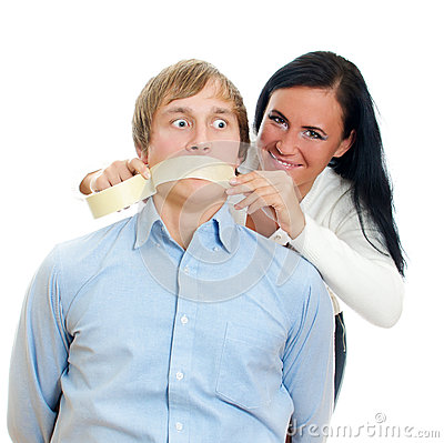 Woman applying tape on man s mouth.
