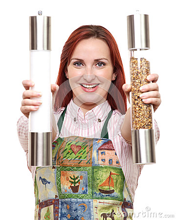 Woman in apron with salt and pepper