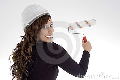 Woman with architect helmet and paint brush