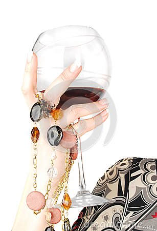 Woman arm with glass of wine.
