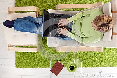 Woman in armchair with laptop