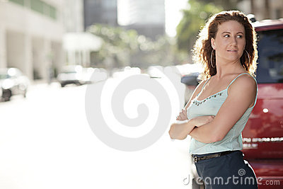 Woman with arms crossed posing on the street
