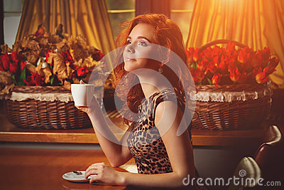 Woman with an aromatic coffee