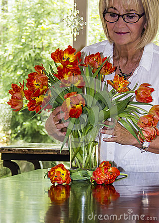 Free Woman Arranging Bouquet Of Colorful Tulips. Stock Photo - 51860390