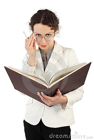 Woman arranging glasses and holding big book