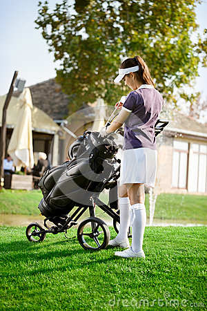 Woman arranging your golf equipment