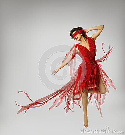 Free Woman Artist Dancing In Red Dress, Girl With Band On Eyes Stock Image - 54274321
