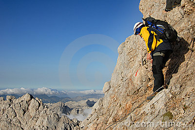 Woman is ascending the  mountain