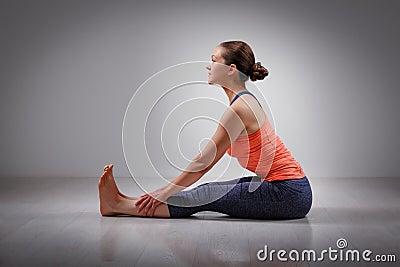 woman in ashtanga vinyasa yoga back bending asana stock