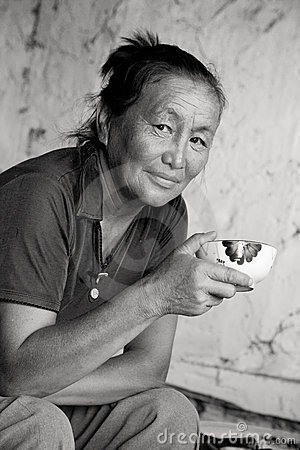A woman of Asian appearance drinking tea