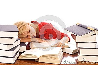 Woman asleep on books
