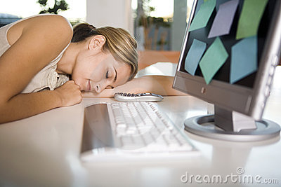 A woman asleep at her computer