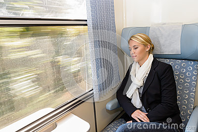 Woman asleep in train compartment tired resting
