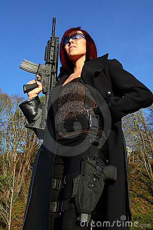 Woman with assault gun