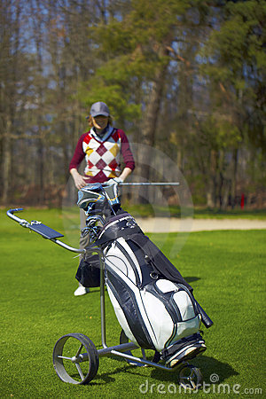 Free Woman At The Golf Range With Trolley Bag Royalty Free Stock Photo - 13851245