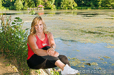 Woman athlete beside pond