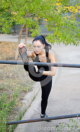 Woman athlete stretching her muscles