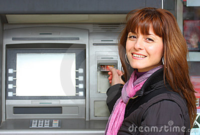 Woman and a ATM outdoor