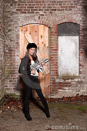 Woman with automatic rifle