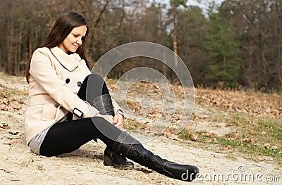 Woman on the autumn beach