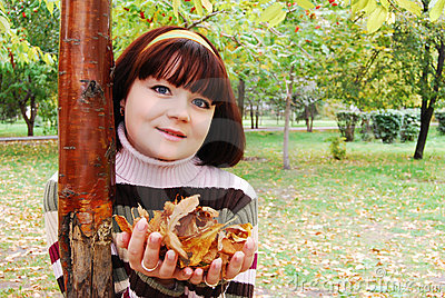 Woman in the autumn park.