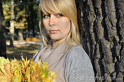 Woman in autumn park