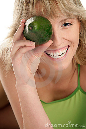 Woman with avocado