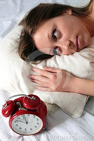 Woman awake with alarm clock