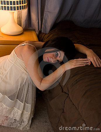 Woman Awake Beside Bed