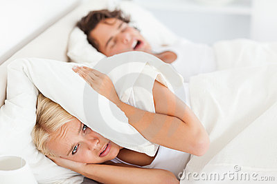 Woman awaken by her husband s snoring