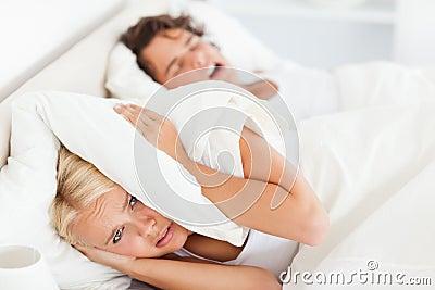 Woman awaken by her husband s snoring