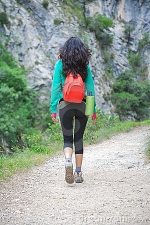 Woman back trekking at Gorge of River Cares