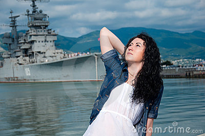 A  woman on the background of a ship