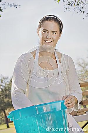 Woman baker mixing dough