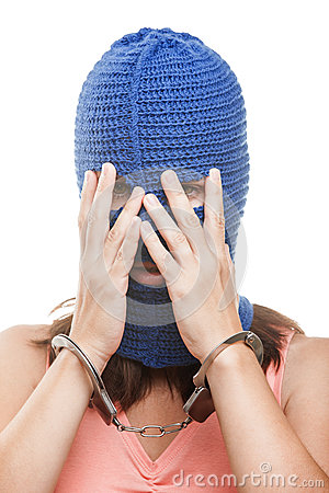 Woman in balaclava hiding face
