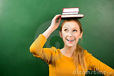 Woman balancing books on head
