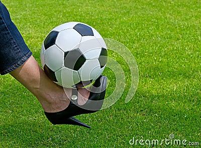Woman balancing football