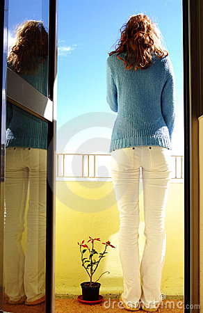 Woman On Balcony Royalty Free Stock Image - Image: 4477846