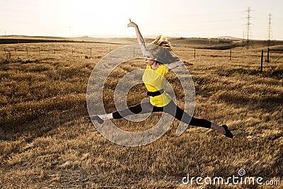 Woman in Balet Jump in a Field